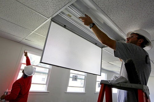 Construction_workers_install_new_energy-efficient_windows_and_lighting